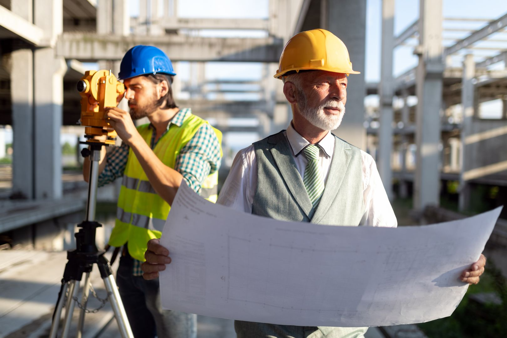two-construction-engineer-working-in-construction-8TCUPRJ